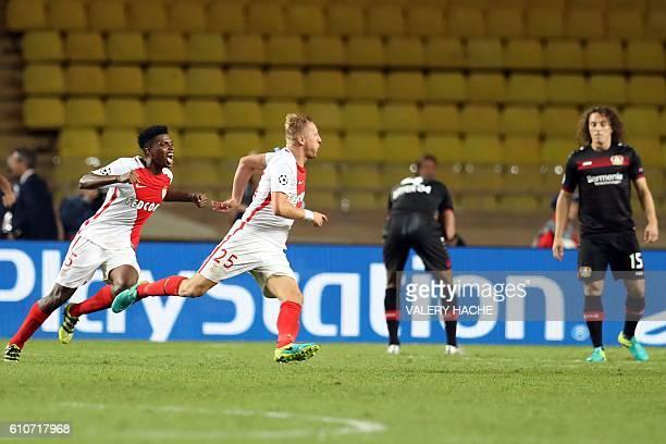 Monaco's Polish defender Kamil Glik celebrates after scoring a goalduring the UEFA Champions League football match AS Monaco vs Bayer Leverkusen on...