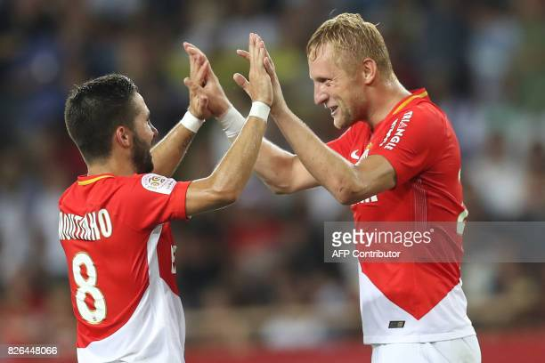 Monaco's Polish defender Kamil Glik celebrates with Monaco's Portuguese midfielder Joao Moutinho after scoring a goal during the French L1 football...