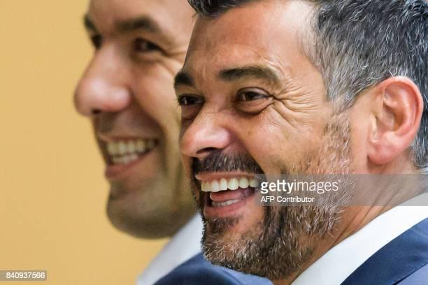 Monaco's Portuguese coach Leonardo Jardim and Porto's Portuguese coach Sergio Conceicao smile after a session of the Elite Club Coaches Forum on...
