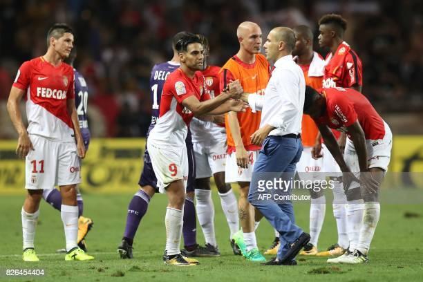 Monaco's Portuguese coach Leonardo Jardim shakes hands with Monaco's Colombian forward Radamel Falcao at the end of the French L1 football match...
