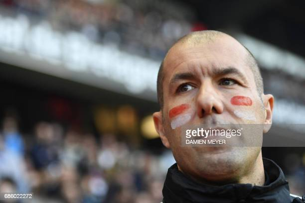 Monaco's Portuguese coach Leonardo Jardim wears his club's colours on his cheeks during the French L1 football match between Rennes and Monaco on May...