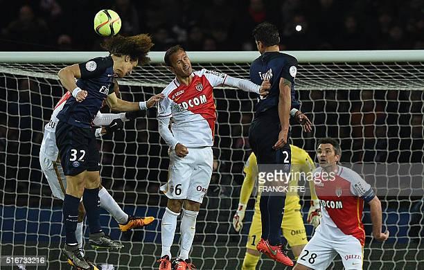 Monaco's Portuguese defender Ricardo Carvalho heads the ball with Paris SaintGermain's Brazilian defenders David Luiz and Thiago Silva during the...