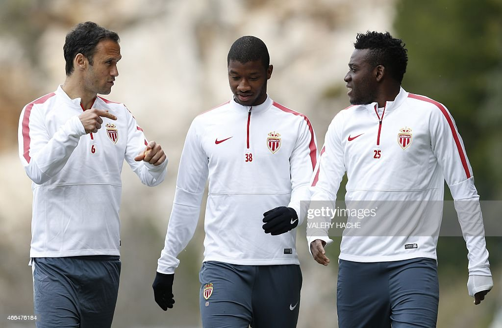Monaco's Portuguese defender <a gi-track='captionPersonalityLinkClicked' href=/galleries/search?phrase=Ricardo+Carvalho&family=editorial&specificpeople=209354 ng-click='$event.stopPropagation()'>Ricardo Carvalho</a> (L) speaks to Monaco's Malian defender Almamy Toure (C) and Monaco's Burkinabe midfielder <a gi-track='captionPersonalityLinkClicked' href=/galleries/search?phrase=Alain+Traore&family=editorial&specificpeople=4146262 ng-click='$event.stopPropagation()'>Alain Traore</a> during a training session on March 16, 2015 in La Turbie, near Monaco, on the eve of their UEFA Champions' League, Round of 16, second leg football match against Arsenal (AFC).