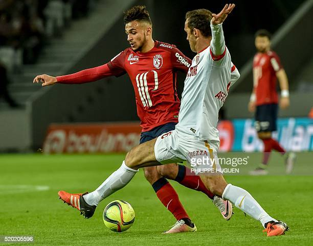Monaco's Portuguese defender Ricardo Carvalho vies with Lille's French midfielder Sofiane Boufal during their french L1 football match Lille vs...
