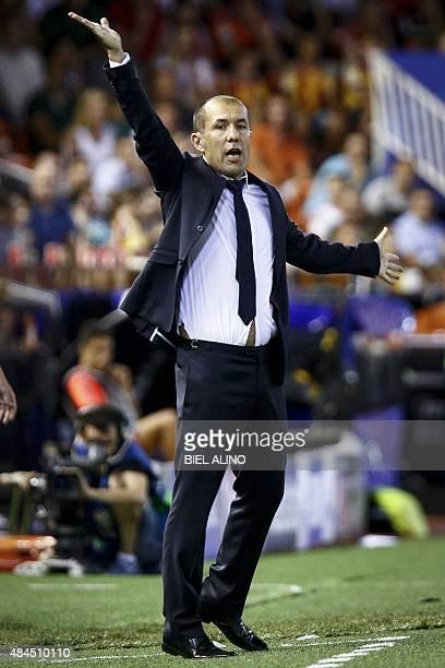 Monaco's Portuguese head coach Leonardo Jardim gestures during the UEFA Champions League playoff football match between Valencia CF vs AS Monaco FC...
