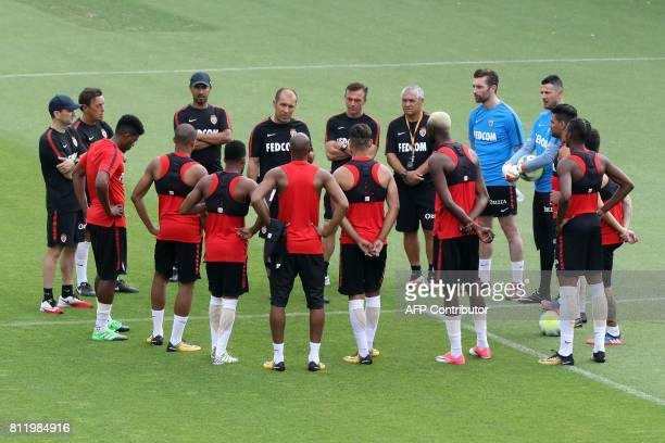 Monaco's Portuguese head coach Leonardo Jardim speaks to players during a training session in La Turbie near Monaco on July 10 2017 / AFP PHOTO /...
