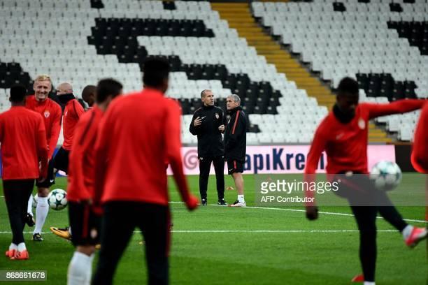 Monaco's Portuguese head coach Leonardo Jardim speaks with Monaco's Portuguese assisstant coach Antonio Vieira during a training session at the...