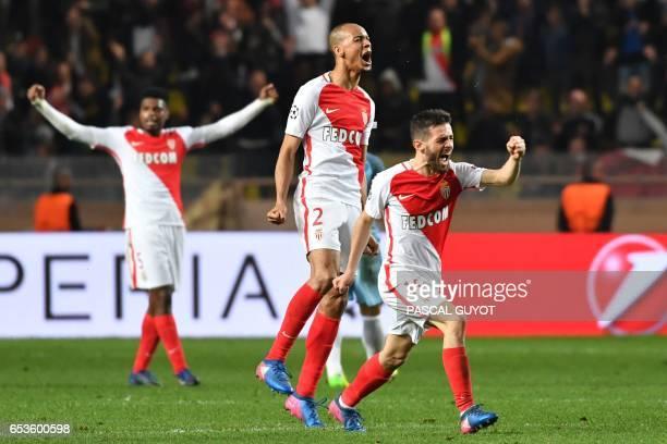 Monaco's Portuguese midfielder Bernardo Silva and Monaco's Brazilian defender Fabinho celebrate at the end of the UEFA Champions League round of 16...