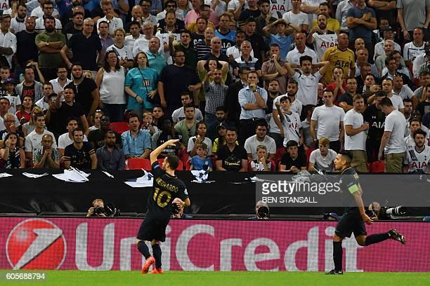 Monaco's Portuguese midfielder Bernardo Silva celebrates after scoring during the UEFA Champions League group E football match between Tottenham...