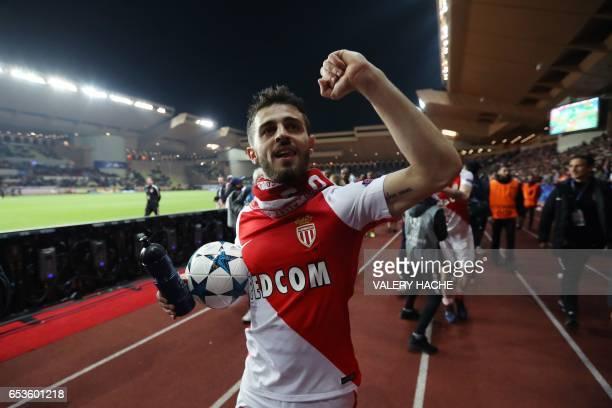 Monaco's Portuguese midfielder Bernardo Silva celebrates at the end of the UEFA Champions League round of 16 football match between Monaco and...