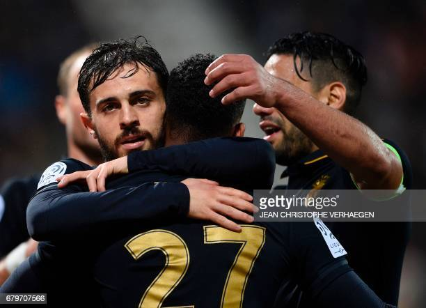 Monaco's Portuguese midfielder Bernardo Silva celebrates with teammates after scoring a goal during the French Ligue 1 football match between Nancy...