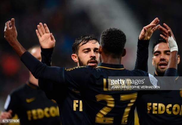 Monaco's Portuguese midfielder Bernardo Silva celebrates with Monaco's French midfielder Thomas Lemar after scoring a goal during the French Ligue 1...