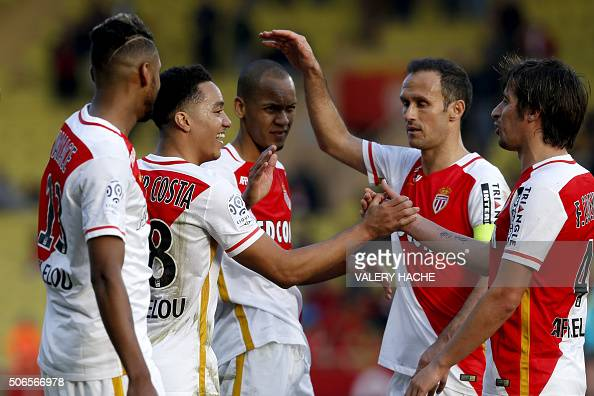 Monaco's Portuguese midfielder Helder Costa celebrates with teammates after scoring a goal during the French L1 football match Monaco vs Toulouse on...