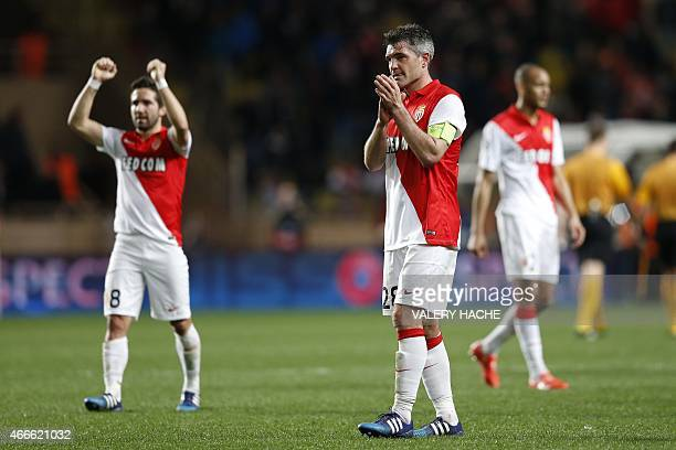 Monaco's Portuguese midfielder Joao Moutinho and French midfielder Jeremy Toulalan celebrate at the end of the UEFA Champions League football match...