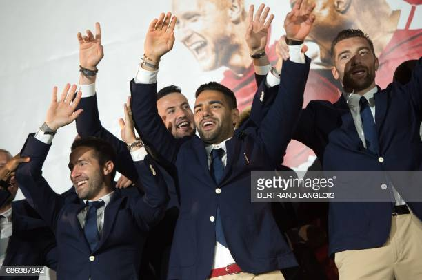 Monaco's Portuguese midfielder Joao Moutinho Croatian goalkeeper Danijel Subasic and Colombian forward Radamel Falcao gesture as they acknowledge...