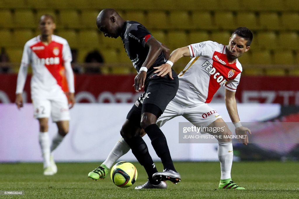 Monaco's Portuguese midfielder Joao Moutinho (R) vies for the ball with Guincamp's French midfielder Younousse Sankhare (L) during the French L1 football match between Monaco (ASM) and Guingamp (EADG) on April 30, 2016, at the Louis II stadium in Monaco.