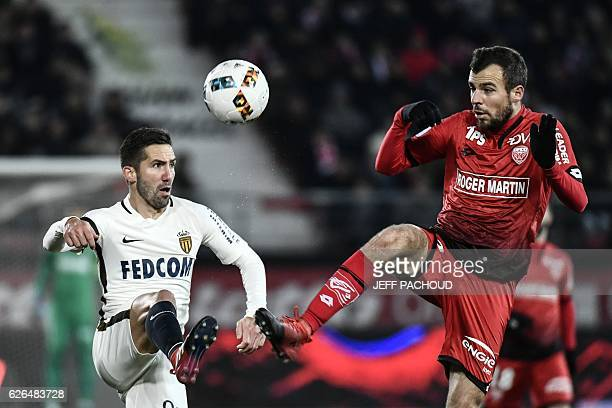 Monaco's Portuguese midfielder Joao Moutinho vies with Dijon's French midfielder Johan Gastien during the French L1 football match Dijon vs Monaco on...