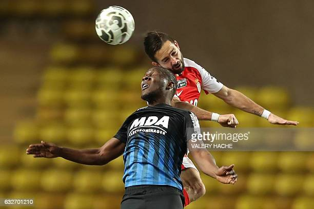 TOPSHOT Monaco's Portuguese midfielder Joao Moutinho vies with Nancy's Mauritanian midfielder Dialo Guidileye during the French League Cup semifinal...
