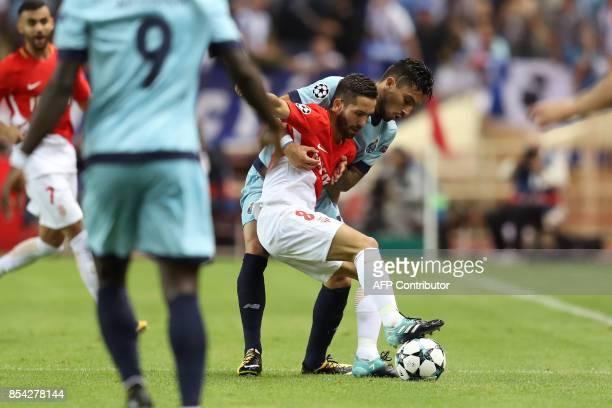 Monaco's Portuguese midfielder Joao Moutinho vies with Porto's Brazilian defender Alex Telles during the UEFA Champions League Group G football match...