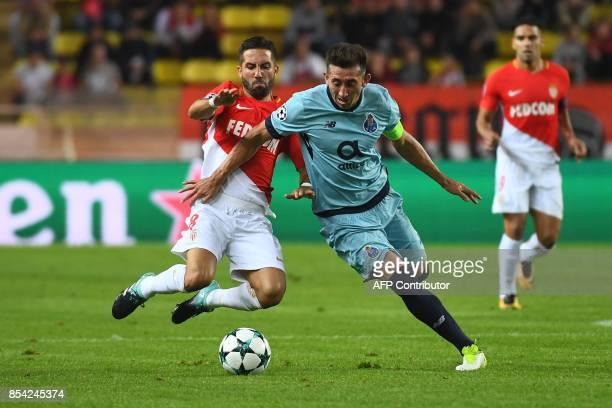 Monaco's Portuguese midfielder Joao Moutinho vies with Porto's Mexican midfielder Hector Herrera during the UEFA Champions League Group G football...