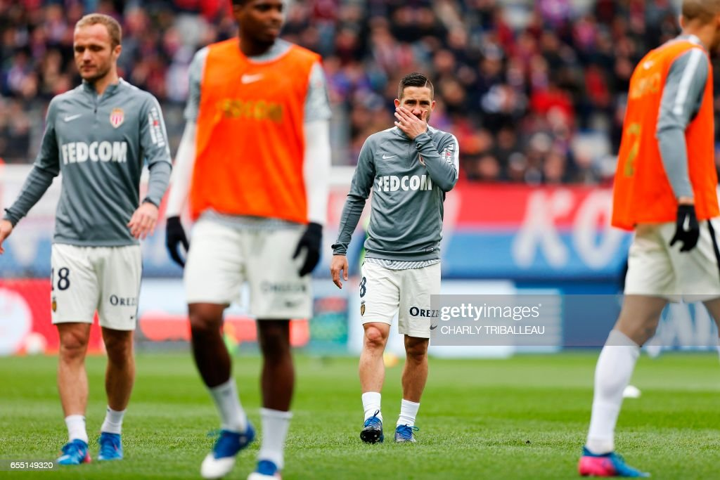 Monaco's Portuguese midfielder Joao Moutinho warms-up before the French L1 football match between Caen (SMC) and Monaco (AS), on March 19, 2017 at the Michel d'Ornano stadium, in Caen, northwestern France. /