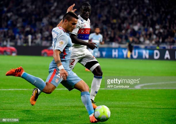 Monaco's Portuguese midfielder Marcos Lopes Mesquita vies with Lyon's French defender Ferland Mendy during the French L1 football match between Lyon...