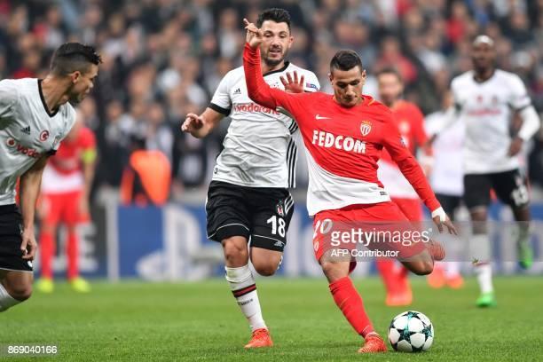 Monaco's Portuguese midfielder Rony Lopes shoots to score as he vies with Besiktas' Turkish midfielder Tolgay Arslan during the UEFA Champions League...