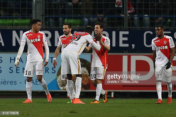 Monaco's Portuguese midfielder Silva Bernardo celebrates with teammates after the second goal during the French L1 football match between Caen and...