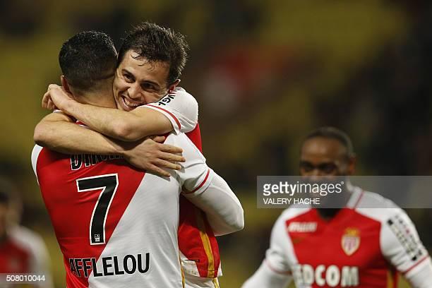 Monaco's Portuguese midfielder Silva Bernardo celebrates with his teammate Monaco's Moroccan midfielder Nabil Dirar after scoring a goal during the...