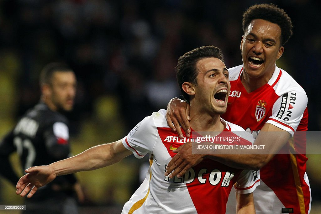 Monaco's Portuguese midfielder Silva Bernardo (L) celebrates with his teammate Monaco's Portuguese midfielder Helder Costa, after scoring a goal during the French L1 football match Monaco (ASM) vs Guingamp (EAG) on April 30, 2016, at the Louis II stadium in Monaco.