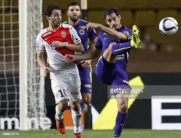 Monaco's Portuguese midfielder Silva Bernardo vies with Caen's French midfielder Nicolas Seube during the French L1 football match between Monaco and...