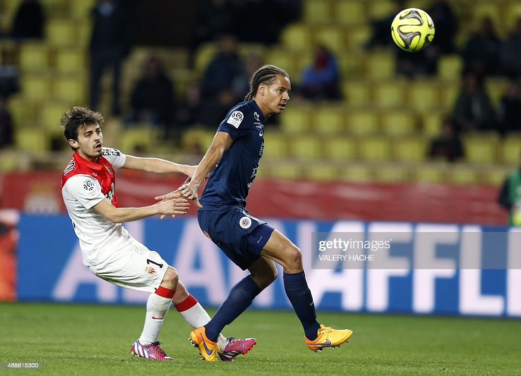Monaco's Portuguese midfielder Silva Bernardo (L) vies with Montpellier's French defender <a gi-track='captionPersonalityLinkClicked' href=/galleries/search?phrase=Daniel+Congre&family=editorial&specificpeople=2167788 ng-click='$event.stopPropagation()'>Daniel Congre</a> (R) during the French L1 football match Monaco (ASM) vs Montpellier (MHSC) on April 7, 2015 at the 'Louis II Stadium' in Monaco. AFP PHOTO / VALERY HACHE