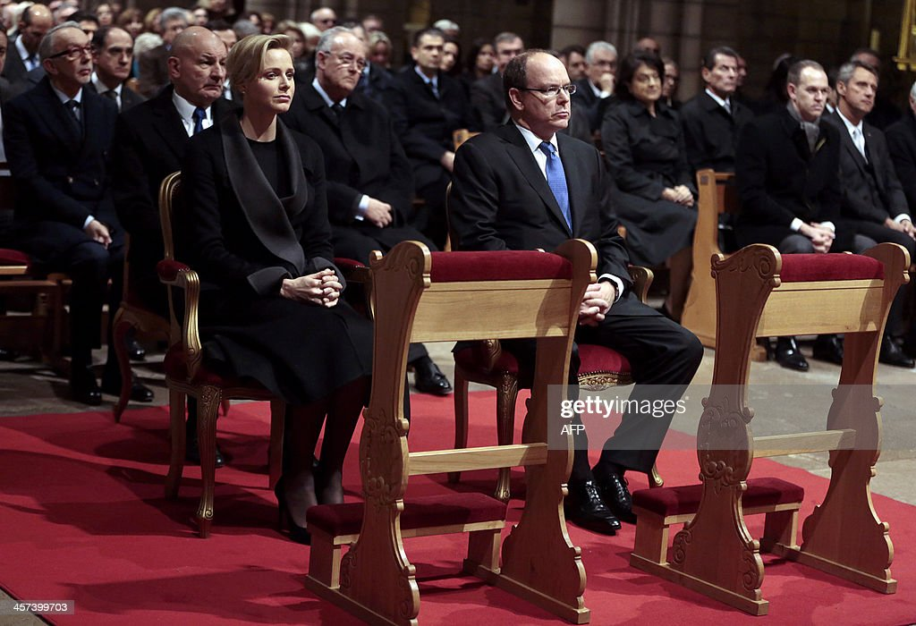 Monaco's Prince Albert II and his wife Princess <a gi-track='captionPersonalityLinkClicked' href=/galleries/search?phrase=Charlene+-+Princess+of+Monaco&family=editorial&specificpeople=726115 ng-click='$event.stopPropagation()'>Charlene</a> attend an ecumenical mass in memory of late South African president Nelson Mandela at the Monaco Cathedral on December 17, 2013. Mandela, the revered icon of the anti-apartheid struggle in South Africa and one of the towering political figures of the 20th century, died in Johannesburg on December 5 at the age of 95. AFP PHOTO/POOL/ERIC GAILLARD
