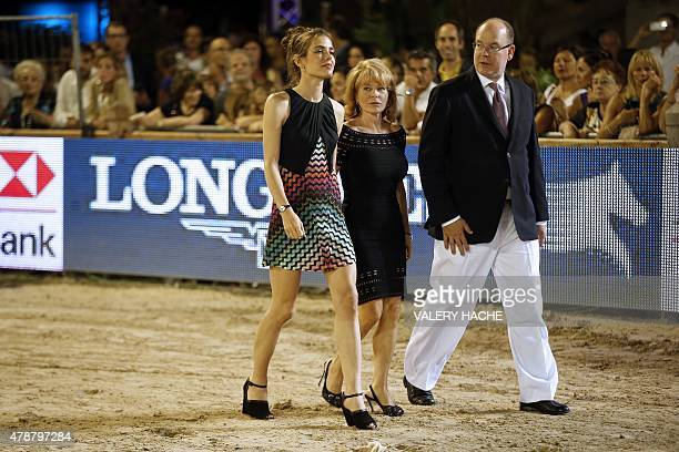 Monaco's Prince Albert II arrives with Monaco International Horse Jumping competition organiser Diane Fissore and his niece Charlotte Casiraghi...