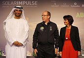 Monaco's Prince Albert II flanked by State Minister and chief executive officer of the Abu Dhabi Future Energy Company Sultan Ahmed alJaber and Swiss...