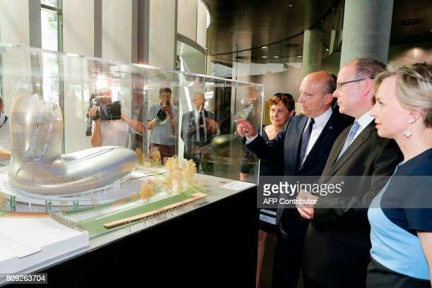 Monaco's Prince Albert listens with Virginie Calmels and Sylvie Caze as the Mayor of Bordeaux Alain Juppe points to a scale model at 'La Cite du Vin'...