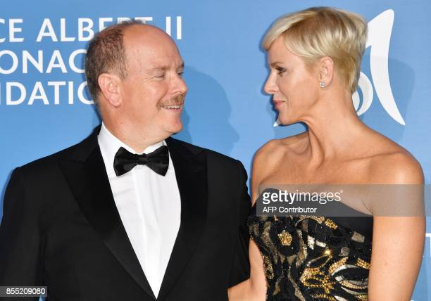 Monaco's Prince Albert poses with Princess Charlene during the MonteCarlo Gala for the Global Ocean in Monaco on September 28 2017 / AFP PHOTO / YANN...