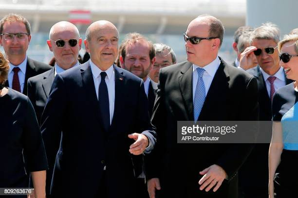Monaco's Prince Albert walks with the Mayor of Bordeaux Alain Juppe and Virginie Calmels as he arrives on a pontoon for a reception at 'La Cite du...