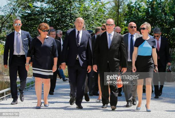 Monaco's Prince Albert walks with the Mayor of Bordeaux Alain Juppe Virginie Calmels and Sylvie Caze as he arrives on a pontoon for a reception at...