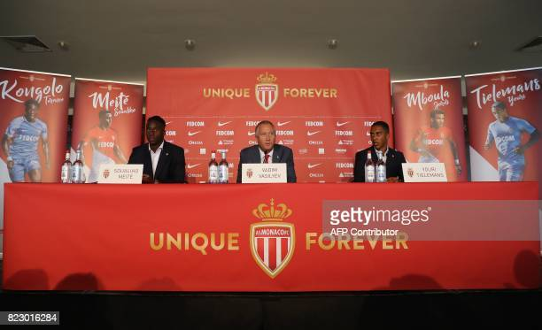 Monaco's Russian club vicepresident Vadim Vasilyev is watched by new players French midfielder Souahilo Meite and Belgian midfielder Youri Tielemans...