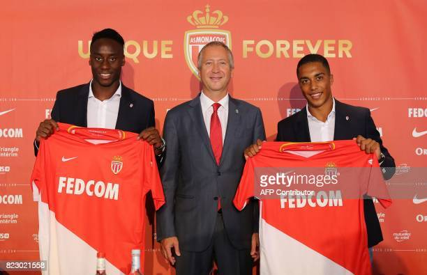 Monaco's Russian club vicepresident Vadim Vasilyev poses with new players French midfielder Souahilo Meite and Belgian midfielder Youri Tielemans...