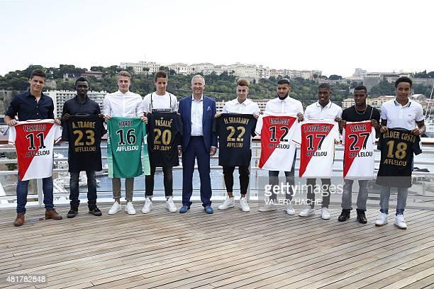 Monaco's Russian football club Vice President Vadim Vasilyev poses with AS Monaco's new players Argentinian forward Guido Carrillo Malian midfielder...