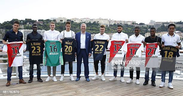 Monaco's Russian football club Vice President Vadim Vasilyev poses with AS Monaco's new players Argentinian forward Guido Carrillo Malian midfielder...