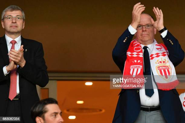 Monaco's Russian President Dmitriy Rybolovlev and Prince Albert II of Monaco applaud as they celebrate Monaco's victory at the end of the French L1...