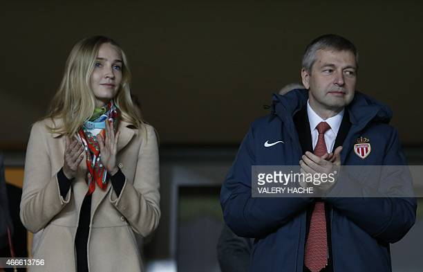 Monaco's Russian president Dmitriy Rybolovlev applauds prior to the UEFA Champions League football match Monaco vs Arsenal on March 17 2015 at Louis...