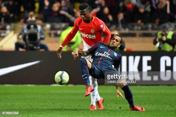 Monaco's Senegalese forward Keita Balde Diao vies for the ball with Paris SaintGermain's Brazilian defender Dani Alves during the French L1 football...