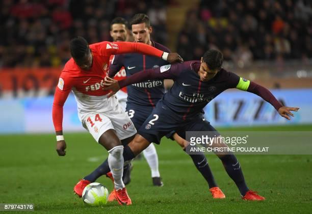 Monaco's Senegalese forward Keita Balde Diao vies for the ball with Paris SaintGermain's Brazilian defender Thiago Silva during the French L1...