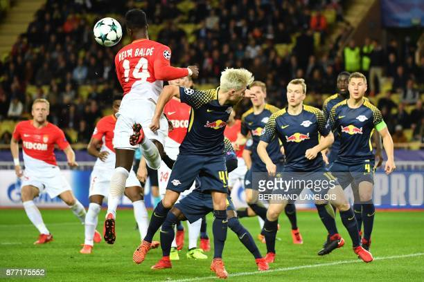 Monaco's Senegalese forward Keita Balde heads the ball during the UEFA Champions League group G football match between Monaco and Leipzig at the...