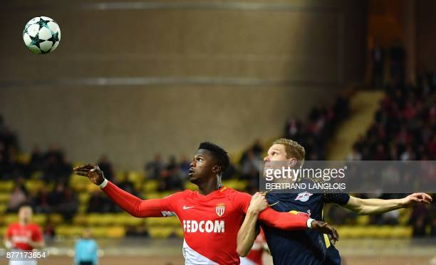 TOPSHOT Monaco's Senegalese forward Keita Balde vies for the ball with Leipzig's German defender Marcel Halstenberg as they eye it during the UEFA...