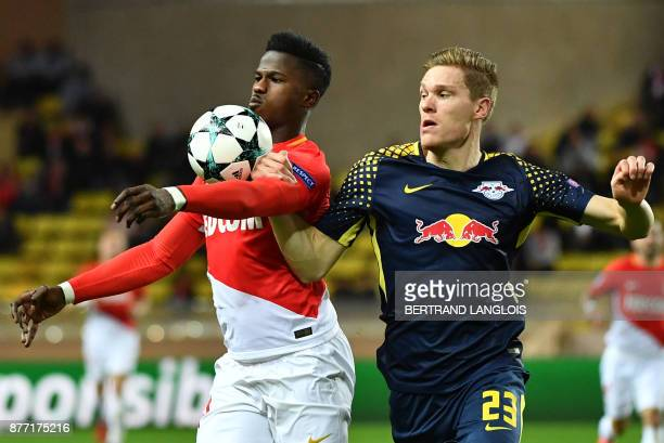 Monaco's Senegalese forward Keita Balde vies for the ball with Leipzig's German defender Marcel Halstenberg during the UEFA Champions League group G...